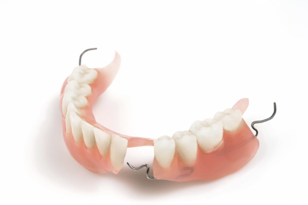 how to keep partial dentures in place